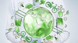 Dessin d'une planète terre verte entourée d'un vélo, d'une prise électrique, d'une voiture électrique, de panneaux solaires, d'éoliennes et d'une ampoule